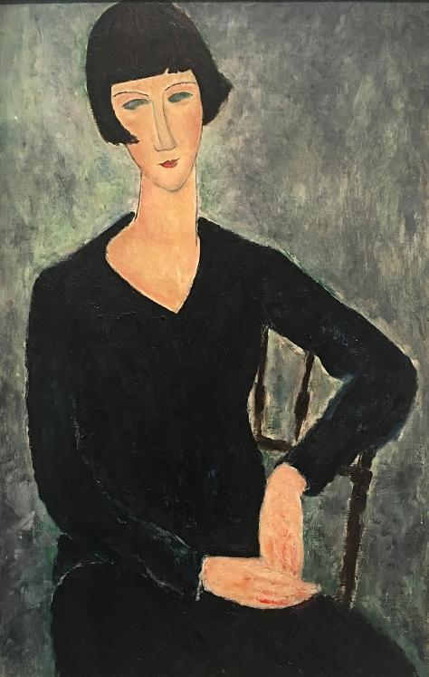 Nainen sinisessä mekossa istuu, 1918.